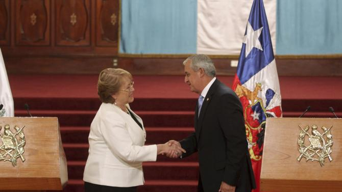 Chile's President Bachelet shakes his hands with Guatemala's President Perez after a news conference in the presidential palace in Guatemala City