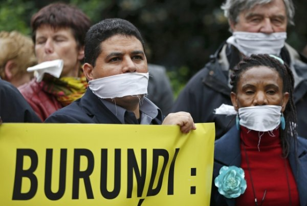 Amnesty International activists demonstrate against new press freedom law in Burundi, in Brussels