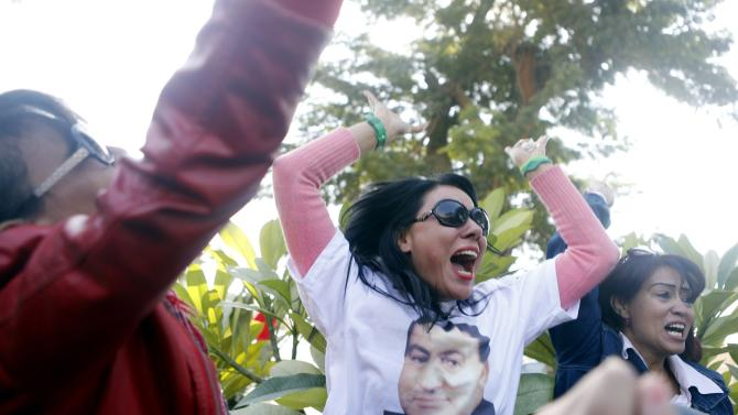 Supporters of former Egyptian President Hosni Mubarak celebrate after hearing the verdict of his trial in Cairo