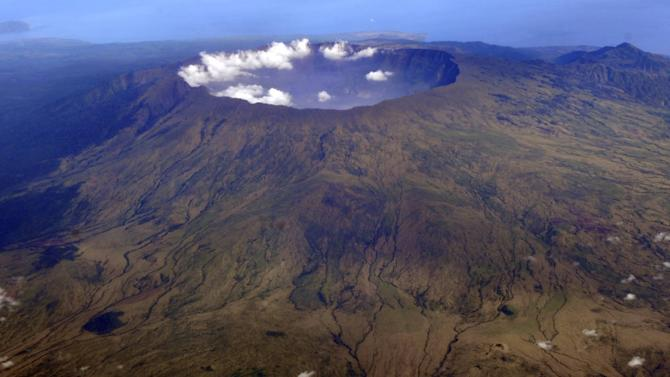 In this Oct. 19, 2010 aerial photo, Mount Tambora's 10 kilometers (more than 7 miles) wide and 1 kilometer (half a mile) deep volcanic crater, created by the April 1815 eruption, is shown. Bold farmers routinely ignore orders to evacuate the slopes of live volcanos in Indonesia, but those on Tambora took no chances when history's deadliest mountain rumbled ominously this month, Sept., 2011. (AP Photo/KOMPAS Images, Iwan Setiyawan) EDITORIAL USE ONLY