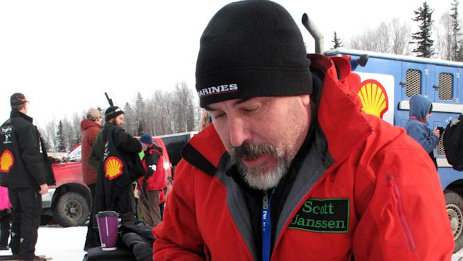 Veteran musher Scott Janssen prepares salmon for his dogs before beginning the Iditarod Trail Sled Dog Race, Sunday, March 3, 2013, in Willow, Alaska. 65 teams will be making their way through punishing wilderness toward the finish line in Nome on Alaska's western coast 1,000 miles away. (AP Photo/Rachel D'Oro)