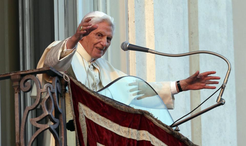 Pope Benedict XVI greets faithful from his summer residence of Castel Gandolfo, the scenic town where he will spend his first post-Vatican days and made his last public blessing as pope,Thursday, Feb. 28, 2013. (AP Photo/Alessandra Tarantino)