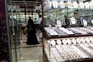 A woman shop at a store in a gold market in Dubai. A survey by the UAE Marriage Fund show that 87% of respondents blamed high dowries for low marriage rates among Emirati women