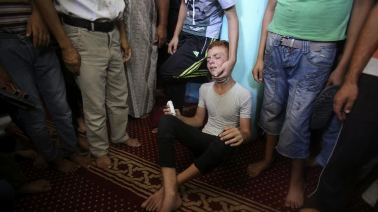A Palestinian reacts during the funeral of three senior Hamas commanders in Rafah