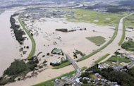 Farmlands are under waters flooded from the Toyo River in central japan on Wednesday Sept. 21, 2011 as powerful Typhoon Roke barreled across central Japan with heavy rains and sustained winds of up to 100 mph (162 kph). (AP Photo/Kyodo News) JAPAN OUT, MANDATORY CREDIT, NO LICENSING IN CHINA, FRANCE, HONG KONG, JAPAN AND SOUTH KOREA
