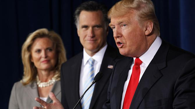 Donald Trump speaks at a news conference in Las Vegas, Thursday, Feb. 2, 2012, to endorse Republican presidential candidate, former Massachusetts Gov. Mitt Romney, center, accompanied by Romney's wife Ann. (AP Photo/Gerald Herbert)