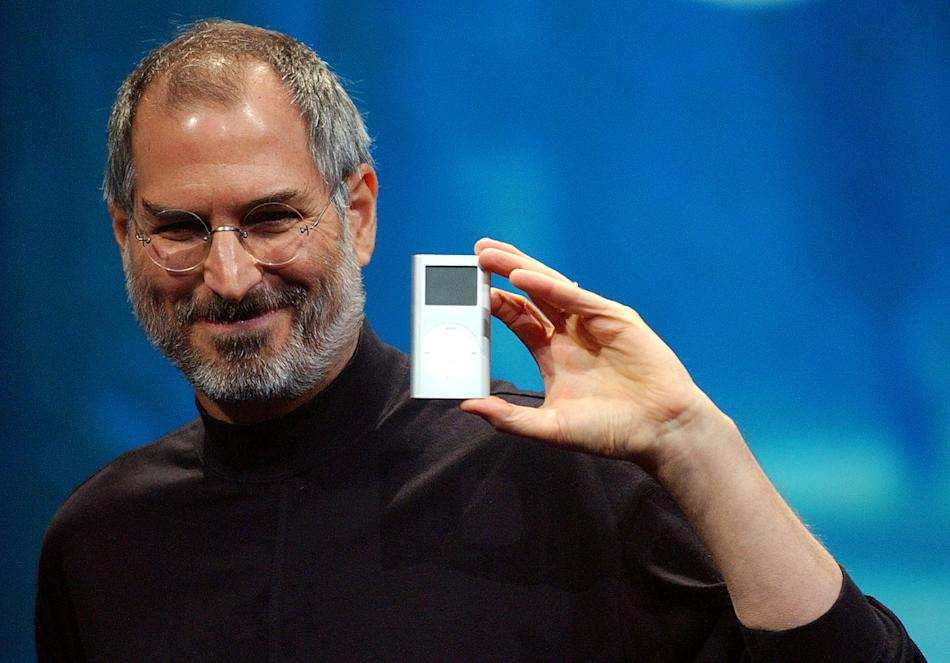 2004 - Apple CEO Steve Jobs displays the iPod mini at the Macworld Conference and Expo in San Francisco. Jobs, the Apple founder and former CEO who invented and masterfully marketed ever-sleeker gadge
