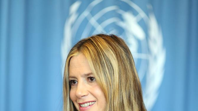 """US actress Mira Sorvino, a UN Goodwill Ambassador to combat human trafficking for the United Nations Office on Drugs and Crime, UNODC, speaks during an interview by the Associated Press at the United Nations in Vienna, Austria, Friday, Feb. 8, 2013. """"I love acting and that is my job right now,"""" Sorvino says. At the same time, she describes her advocacy against human trafficking and modern-day slavery as """"my calling,"""" and so important that """"in a decade or so, I wouldn't mind just switching to a career in humanitarian causes."""" (AP Photo/Alexander Mueller)"""