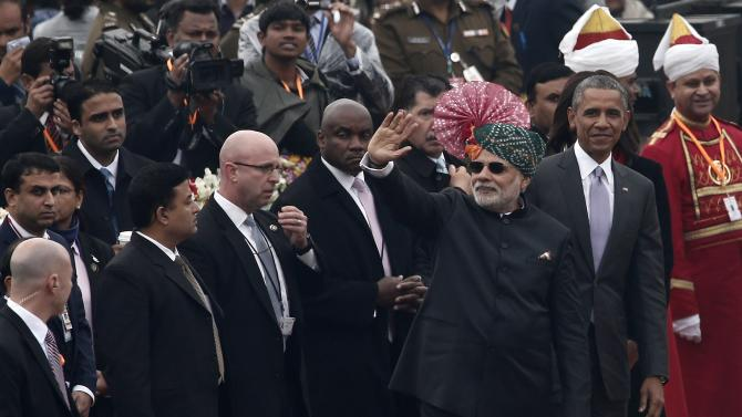 Indian PM Modi waves as U.S. President Obama watches after attending the Republic Day parade in New Delhi