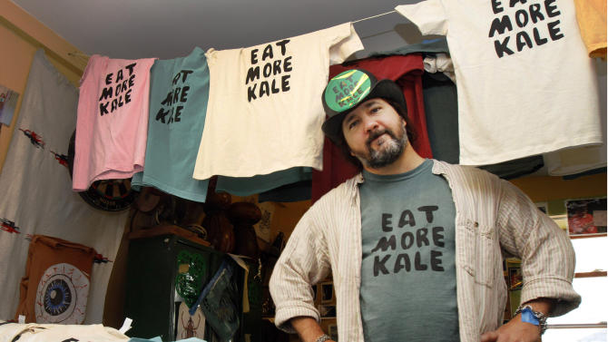 "FILE-  In this Nov. 22, 2011 file photo, Bo Muller-Moore stands in his home studio in Montpelier, Vt. Muller-Moore, the Vermont man who is building a business around the term ""eat more kale,"" which has been plastered on T-shirts, bumper stickers and other items, is ran into opposition this year from the second largest fried chicken retailer in the country, Chick-fil-A. (AP Photo/Toby Talbot, File)"