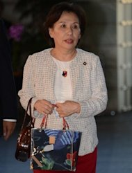 Newly appointed Education, Culture, Sports and Science Minister Makiko Tanaka enters the prime minister's official residence in Tokyo, on October 1. Japanese PM Yoshihiko Noda reshuffled his cabinet, in what commentators said was a bid to refloat his sinking popularity and to signal to Beijing his intention to put a territorial row aside