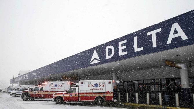 Ambulances are seen at LaGuardia Airport's Terminal D during a snow storm in New York