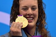 US swimmer Allison Schmitt poses on the podium with the gold medal after winning the women's 200m freestyle final during the swimming event at the London 2012 Olympic Games in London