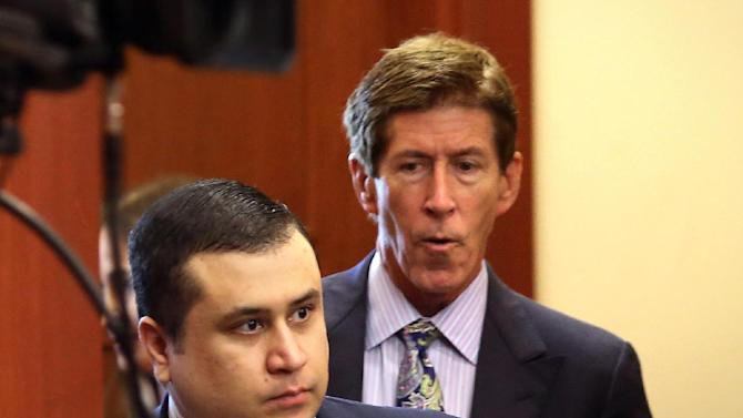 """George Zimmerman, defendant in the killing of Trayvon Martin, arrives in Seminole circuit court, in Sanford, Fla., with his attorney Mark O'Mara, right, for a pre-trial hearing, Tuesday, April 30, 2013.  Zimmerman says he agrees with his attorneys' decision not to seek an immunity hearing under the state's """"Stand Your Ground"""" self-defense law. (AP Photo/Orlando Sentinel, Joe Burbank, Pool)"""