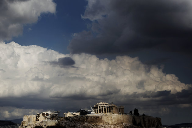 Clouds above the ancient Acropolis hill with the Parthenon temple, in Athens, on Monday, Sept. 17, 2012. Greece's government is trying to finalize an euro 11.5 billion ($15 billion) austerity package required for continued emergency rescue loans. Unions are angry at the new cuts and have called a general strike for Sept. 26. (AP Photo/Petros Giannakouris)