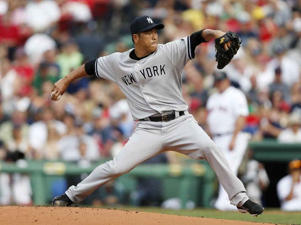New York Yankees' Hiroki Kuroda, of Japan, pitches in the first inning of a baseball game against the Boston Red Sox in Boston, Saturday, July 20, 2013. (AP Photo/Michael Dwyer)