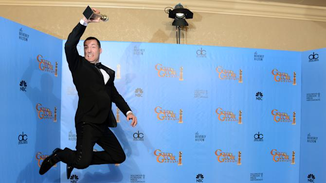 """Director Mark Andrews poses with the award for best animated feature film for """"Brave"""" backstage at the 70th Annual Golden Globe Awards at the Beverly Hilton Hotel on Sunday Jan. 13, 2013, in Beverly Hills, Calif. (Photo by Jordan Strauss/Invision/AP)"""