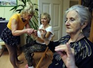 "Ludwika Kochman (left) a volunteer of the ""Little Brothers of the Poor"" association which supports seniors citizens, leads a gym session in Poznan, Poland on March 5"
