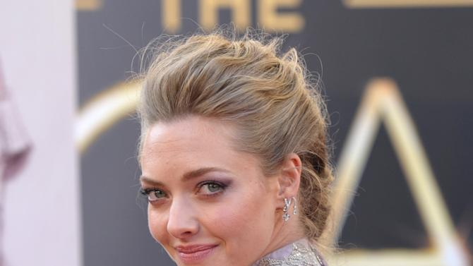 Actress Amanda Seyfried arrives at the Oscars at the Dolby Theatre on Sunday Feb. 24, 2013, in Los Angeles. (Photo by John Shearer/Invision/AP)