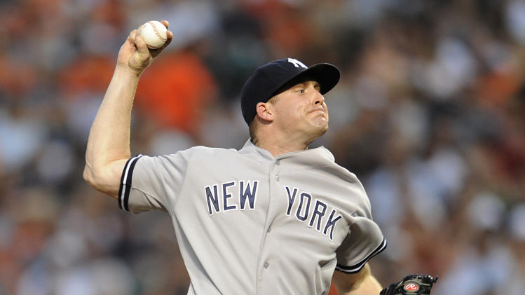 New York Yankees pitcher Chase Whitley delivers against the Baltimore Orioles in the first inning of a baseball game, Sunday, July 13, 2014, in Baltimore.(AP Photo/Gail Burton)