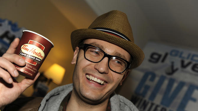 Musician Erick Macek drinks Tim Hortons cafe & bake shop coffee at the Fender Music lodge during the Sundance Film Festival on Monday, Jan. 21, 2013, in Park City, Utah. (Photo by Jack Dempsey/Invision for Fender/AP Images)
