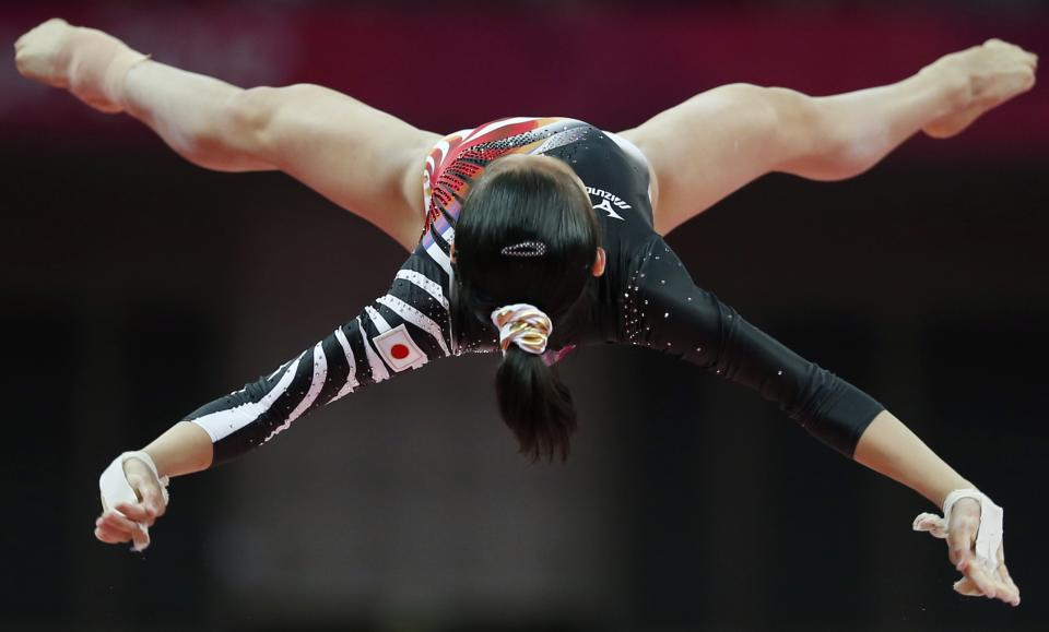 Japanese gymnast Yu Minobe performs on the uneven bars during the artistic gymnastics women's qualifications at the 2012 Summer Olympics, Sunday, July 29, 2012, in London. (AP Photo/Matt Dunham)