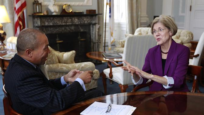 U.S. Sen.-elect Elizabeth Warren, D-Mass., right, speaks with Mass. Gov. Deval Patrick, during a meeting in the governor's office at the Statehouse, in Boston, Thursday, Nov. 8, 2012. (AP Photo/Steven Senne)