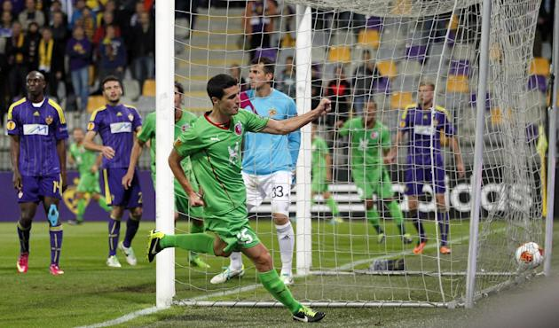 Rubin Kazan's Ivan Marcano, center, celebrates his goal against Maribor, during their group D Europa League first round first leg soccer match, in Maribor, Slovenia, Thursday, Sept. 19, 2013