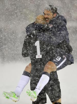 United States goalkeeper Brad Guzan (1) celebrates with Herculez Gomez (9) following a 1-0 victory against Costa Rica during a World Cup qualifier soccer match in Commerce City, Colo., Friday, March 22, 2013. (AP Photo/Jack Dempsey)