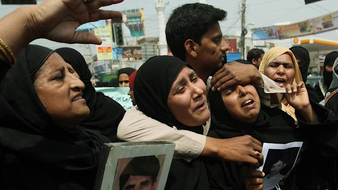 Family members of stranded Pakistanis in Yemen protest to demand their return, as they gather in Multan, Pakistan, Wednesday, April 1, 2015. Pakistan evacuated some 500 of its citizens by a special plane from the Yemeni city of Hodeida. Pakistan said some 3,000 of its citizens live in Yemen. (AP Photo/Asim Tanveer)