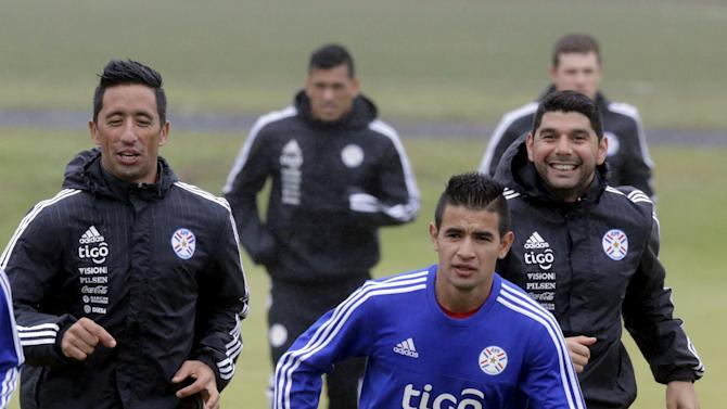 Paraguay's national soccer team players Lucas Barrios, Derlis Gonzalez and Nestor Ortigoza attend a training session in Ypane
