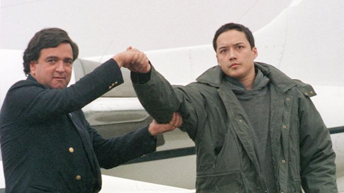 FILE - In this Nov. 27, 1996 file photo, U.S. Rep. Bill Richardson, D-N.M., left, shakes hands with Evan C. Hunziker of Tacoma, Washington, upon their arrival at Yokota Air Base on the outskirts of Tokyo.  Hunziker, 26, who was jailed for three months in North Korea on spy charges was freed and arrived in Japan with Richardson who negotiated his release. Time and again, Americans over the years have slipped into poor, deeply suspicious, fervently anti-American North Korea, crossing a border that tens of thousands of desperate North Koreans have crossed in the opposite direction, at great risk. Whatever their reasons, Americans detained in North Korea, including the three currently there, are major complications for Washington, which must decide between letting a U.S. citizen languish and providing Pyongyang with a huge propaganda victory by sending a senior U.S. envoy to negotiate a release. (AP Photo/Katsumi Kasahara)