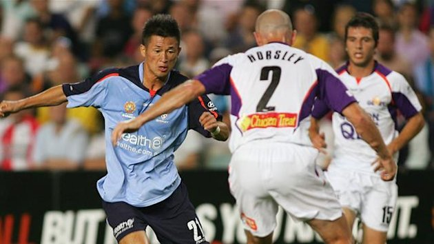 "2009 A-League Sydney FC's Japanese soccer star Kazuyoshi ""Kazu"" Miura (L) dribbles the ball past Perth Glory's Matt Horsley (C) and Billy Celeski (R)"
