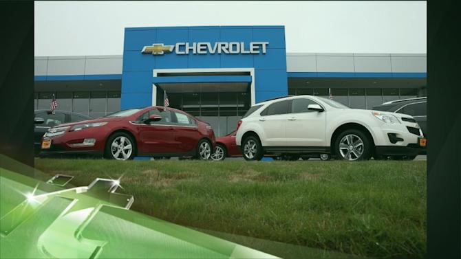 Latest Business News: GM Cuts Price of Volt Electric Car by 13 Percent