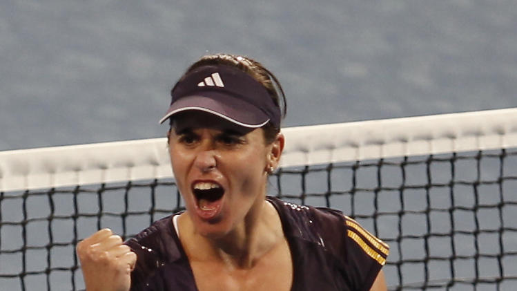 Spain's Anabel Medina Garrigues reacts after defeating Serbia's Ana Ivanovich during the women's final at the Hopman Cup tennis tournament in Perth, Australia, Jan. 5, 2013. Garrigues won the match 6-4 6-7 6-2. (AP Photo/ Theron Kirkman)