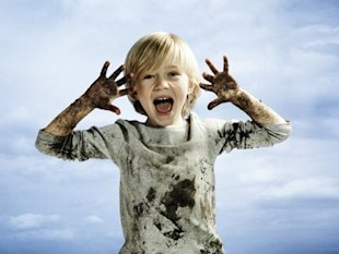 Child covered in dirt.