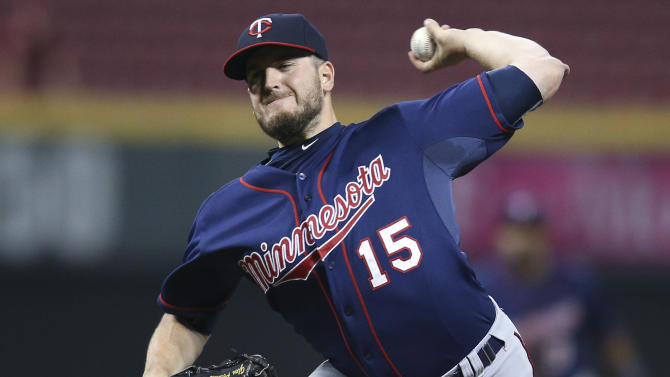 Minnesota Twins relief pitcher Glen Perkins throws in the ninth inning of a baseball game against the Cincinnati Reds, early Wednesday, July 1, 2015, in Cincinnati. The Twins won 8-5. (AP Photo/John Minchillo)