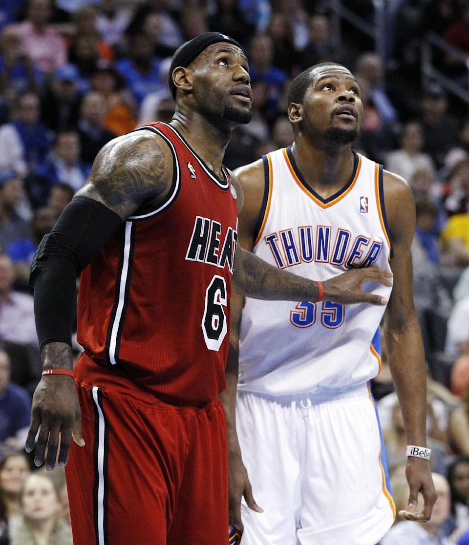 Miami Heat forward LeBron James (6) and Oklahoma City Thunder forward Kevin Durant (35) watch a foul shot during the third quarter of an NBA basketball game in Oklahoma City, Thursday, Feb. 14, 2013. Miami won 110-100. (AP Photo/Sue Ogrocki)