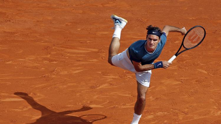 Federer serves to Djokovic during their semi-final match at the Monte Carlo Masters in Monaco