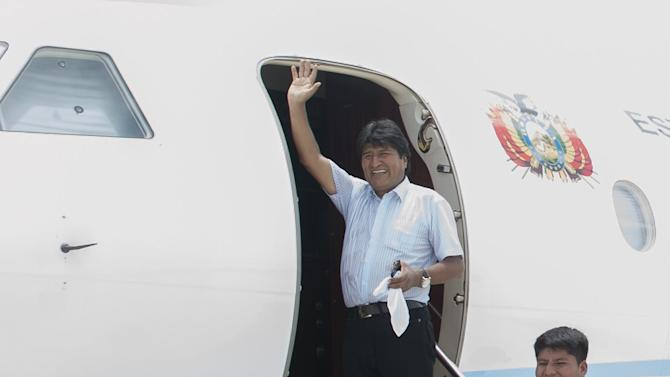 Bolivia's President Evo Morales waves upon his arrival to inauguration ceremony of  a new military air force training center in Chimore