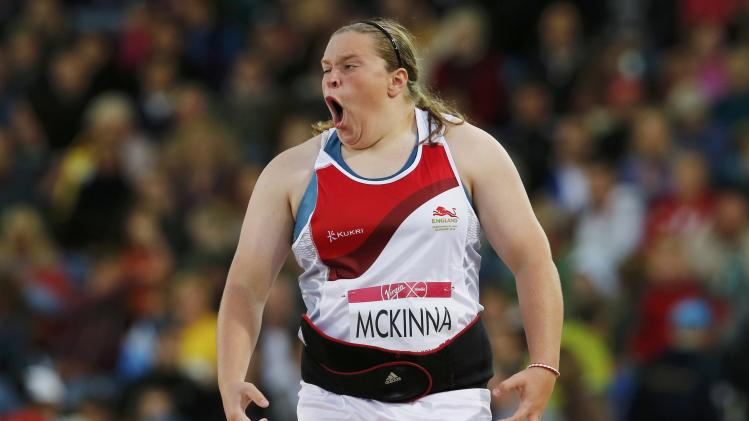 McKinna of England reacts as she competes in the Women's Shot Put final at the 2014 Commonwealth Games in Glasgow