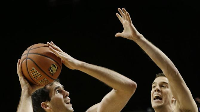 Stanford's Stefan Nastic, left, looks for a shot against Duke's Marshall Plumlee during the first half of an NCAA college basketball game for first place in the Coaches vs. Cancer Classic, Saturday, Nov. 22, 2014, in New York. (AP Photo/Seth Weng)