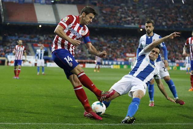Atletico's Gabi, left, vies for the ball with Espanyol's Juan Fuentes, right, during a Spanish La Liga soccer match between Atletico Madrid and Espanyol at the Vicente Calderon stadium in Madr