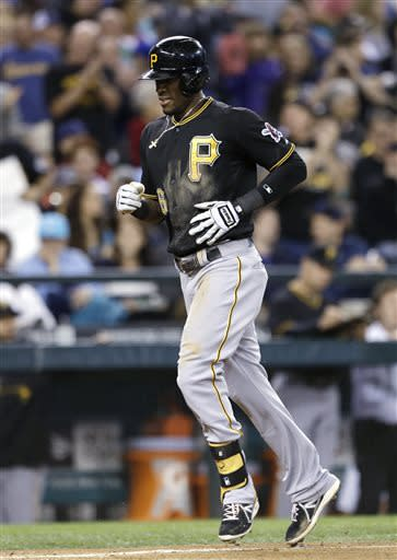Pirates hit 5 HRs, back Locke in 9-4 win over M's