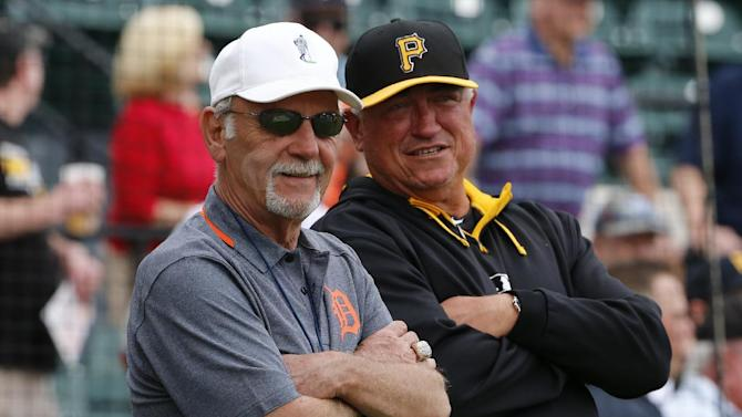 Former Detroit Tigers manager Jim Leyland, left, visits with Pittsburgh Pirates manager Clint Hurdle before an exhibition spring training baseball game between the Detroit Tigers and the Pittsburgh Pirates in Lakeland, Fla., Tuesday, March 4, 2014. (AP Photo/Gene J. Puskar)