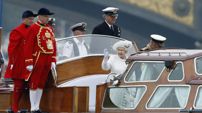 Britain's Queen Elizabeth II waves as she travels on a launch boat to be taken to the royal barge, the principal boat of a flotilla of 1,000 vessels on the River Thames, during a river pageant to celebrate the queen's Diamond Jubilee in London, Sunday, June 3, 2012.  An armada of vessels, from historic sailboats and barges to kayaks, lifeboats and military launches, took part in Sunday's river pageant to mark the queen's 60 years on the throne.  (AP Photo/Matt Dunham, Pool)