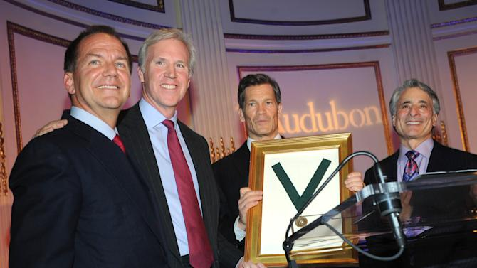 IMAGE DISTRIBUTED FOR THE NATIONAL AUDUBON SOCIETY - Louis Bacon, center, is presented the Audubon Medal and is joined on stage with Paul Tudor Jones, left, Holt Thrasher, second left, Chairman, The National Audubon Society, and David Yarnold, right, President & CEO, The National Audubon Society, at the organization's first gala to jointly award the Audubon Medal and the inaugural Dan W. Lufkin Prize for Environmental Leadership, Thursday, Jan. 17, 2013, in New York.  (Photo by Diane Bondareff/Invision for The National Audubon Society/AP Images)