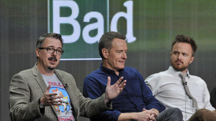 "Vince Gilligan, left, creator and executive producer of ""Breaking Bad,"" answers a question as cast members Bryan Cranston, center, and Aaron Paul listen during AMC's Summer 2013 TCA press tour at The Beverly Hilton Hotel on Friday, July 26, 2013, in Beverly Hills, Calif. When ""Breaking Bad"" ends this season, fans will be left with a documentary that recounts the show's history. Gilligan said the film is comprehensive and, in his words, really good. (Photo by Chris Pizzello/Invision/AP)"