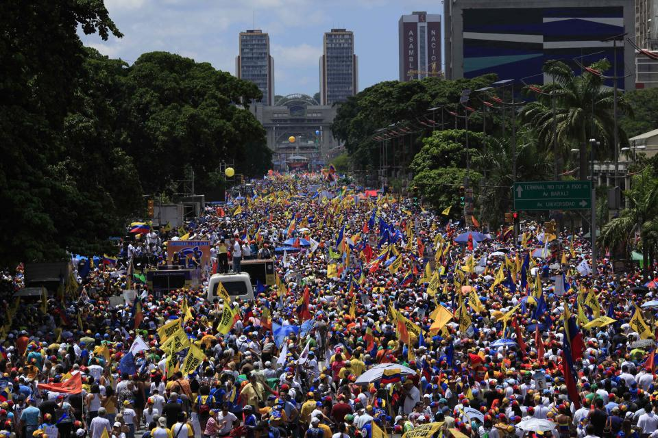 Supporters of opposition presidential candidate Henrique Capriles gather during a campaign rally in Caracas, Venezuela, Sunday, Sept. 30, 2012. Presidential elections in Venezuela are scheduled for Oct. 7. (AP Photo/Ariana Cubillos)