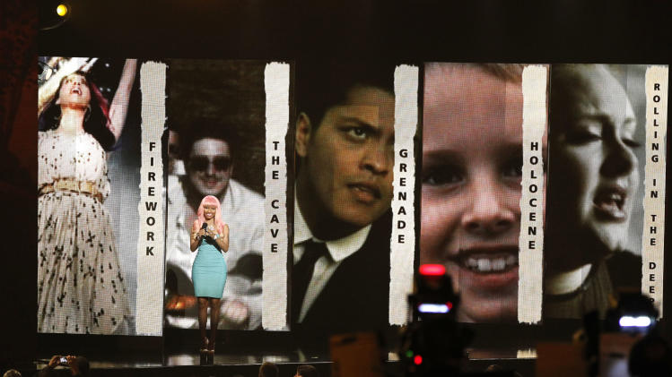 Nicki Minaj announces the nominees for record of the year at the Grammy Nominations Concert on Wednesday, Nov. 30, 2011 in Los Angeles. (AP Photo/Matt Sayles)